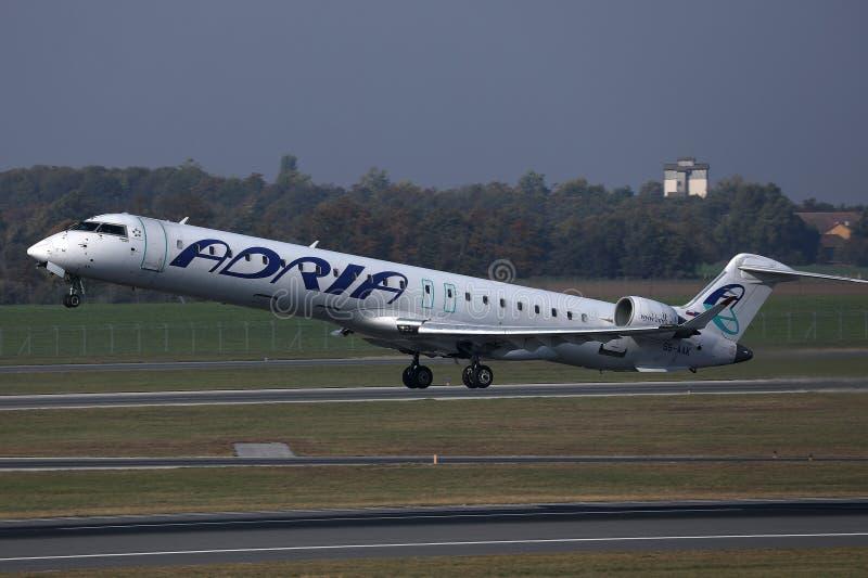 Adria Airways plane taking off. Adria Airways jet takes off from runway stock photos
