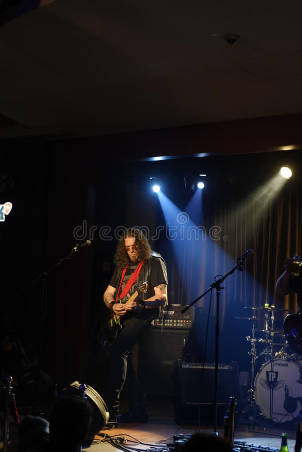 Adrian Barar onstage. Singer and guitar player Adrian Barar from rock group Cargo performing onstage stock images