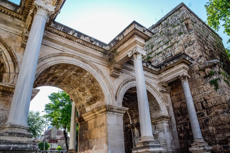 Adrian Gate, Antalya landmark, Turkey. Antique construction of marble and. Adrian Gate, Antalya landmark, Turkey. Antique ancient construction of marble and royalty free stock photos