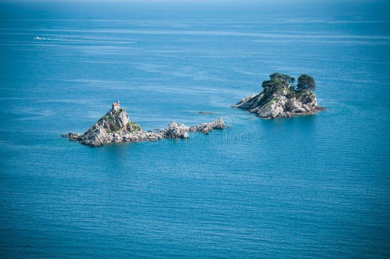 Adriatic Islets. Two little islets on the Adriatic Sea with church Sveta Nedelja near Petrovac, Montenegro stock photography