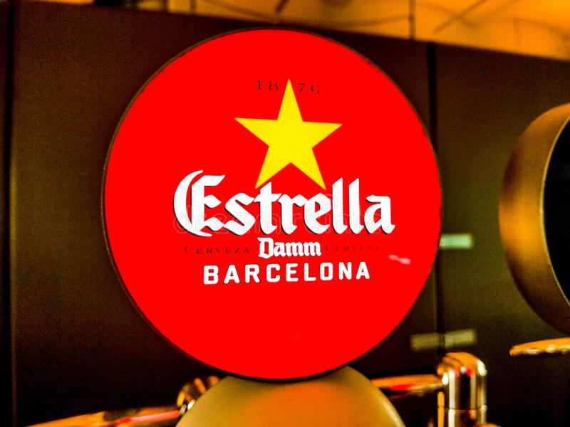 The ads of Estrella Damm beer inside of the old factory. Barcelona, October 2017. royalty free stock photography