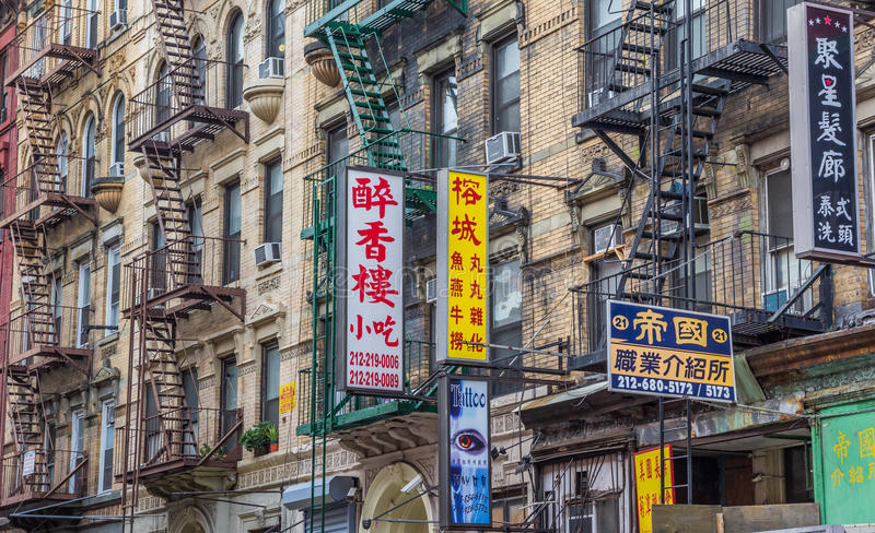 Ads and fire stairs in Chinatown, New York City. America royalty free stock image