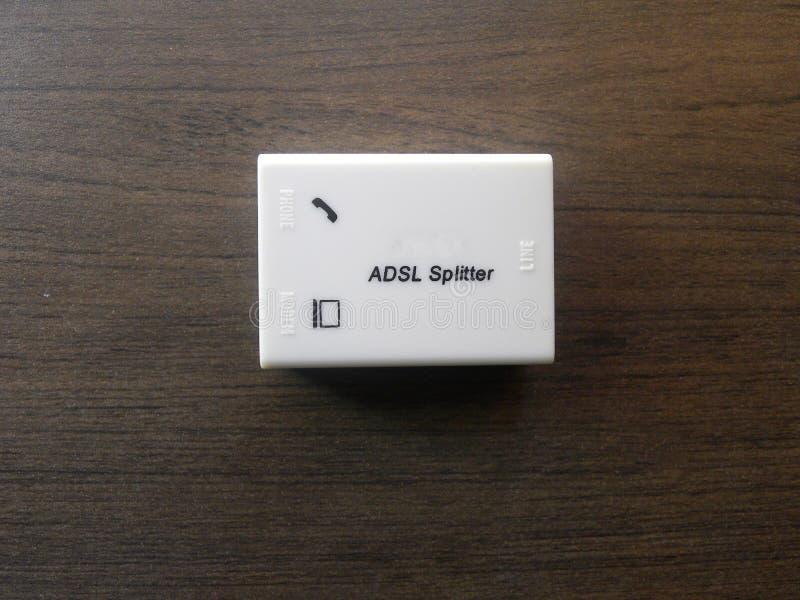 ADSL Splitter. White color ADSL Asymmetric Digital Subscriber Line splitter and filter kept on wooden table stock images