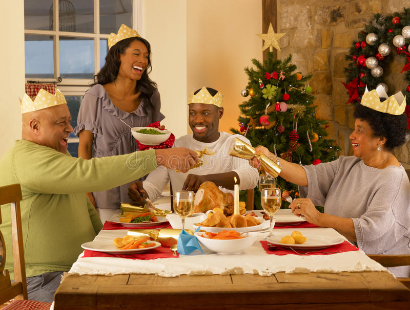 Adult African American family having dinner. Adult African American family having Christmas dinner stock images