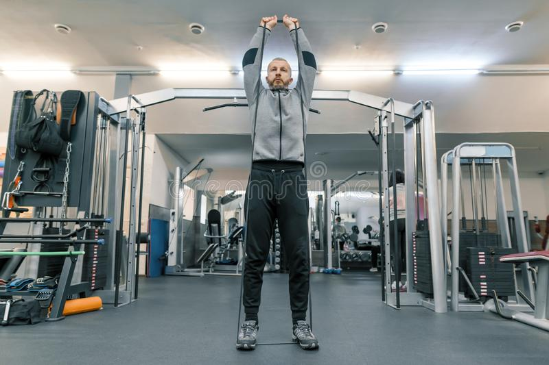 Adult age man working in training gym. Sport rehabilitation, age, healthy lifestyle concept royalty free stock photography
