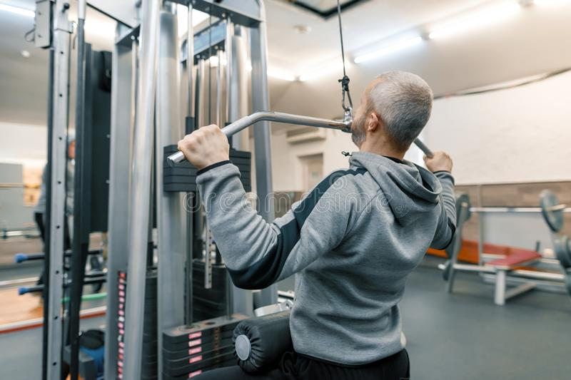 Adult age man working in training gym. Sport rehabilitation, age, healthy lifestyle concept royalty free stock photos