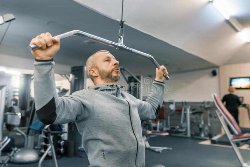 Adult age man working in training gym. Sport rehabilitation, age, healthy lifestyle concept royalty free stock images