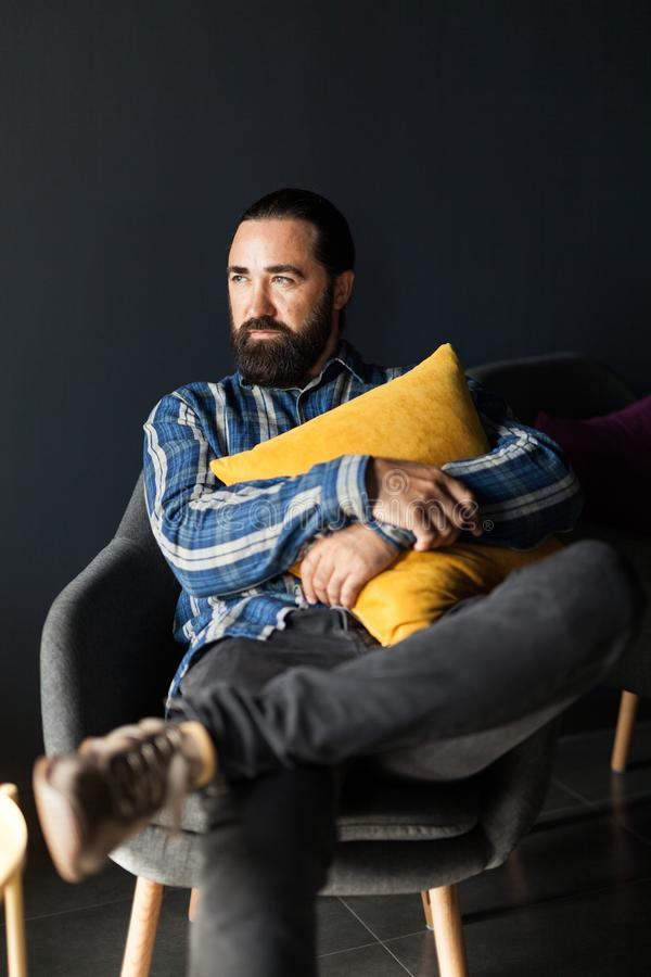 Adult beard man relax on chair. Total relaxation.  royalty free stock image