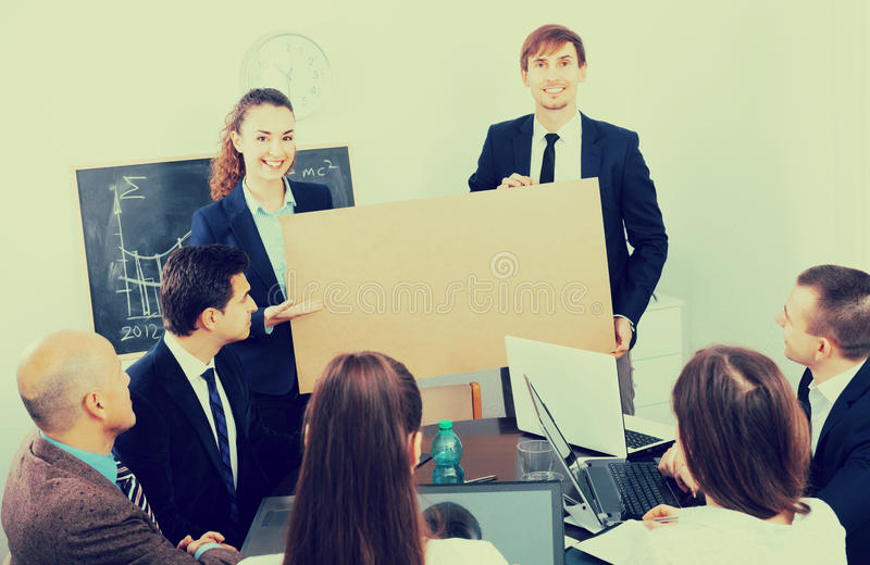 Adult business people presenting products plan stock image