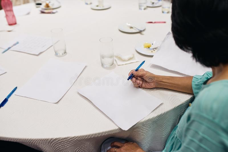 Adult business women start to writing idea on the white paper royalty free stock photos