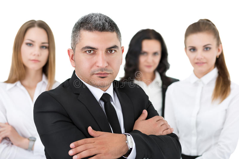 Adult businessman standing in front of his colleagues royalty free stock photos