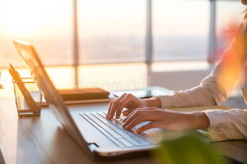 Adult businesswoman working at home using computer, studying business ideas on a pc screen stock image