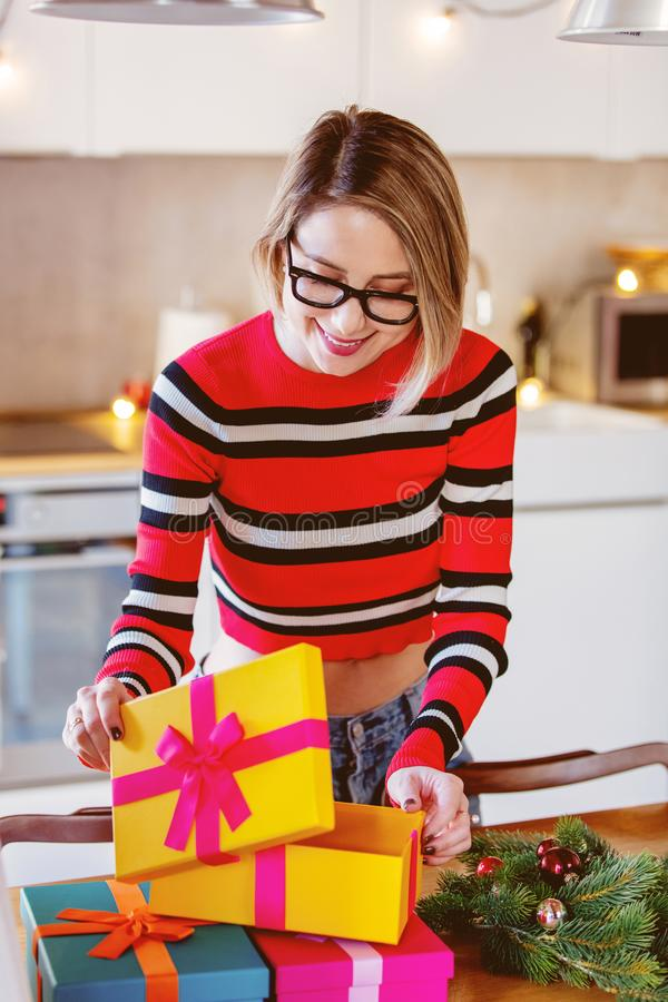 Adult caucasian girl with Christmas gift stock images