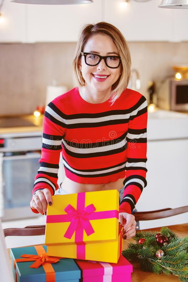 Adult caucasian girl with Christmas gift stock photo