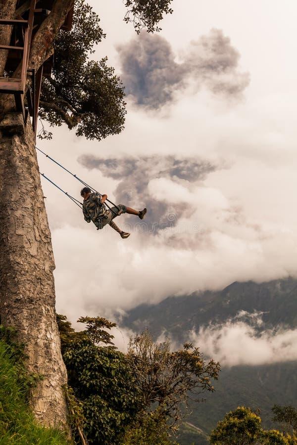 Adult Caucasian Man Swinging On A Swing In Banos De Agua Santa royalty free stock photo