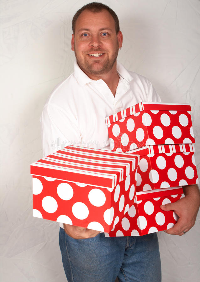 Free Adult Caucasian Man With Christmas Boxes Royalty Free Stock Images - 17167859