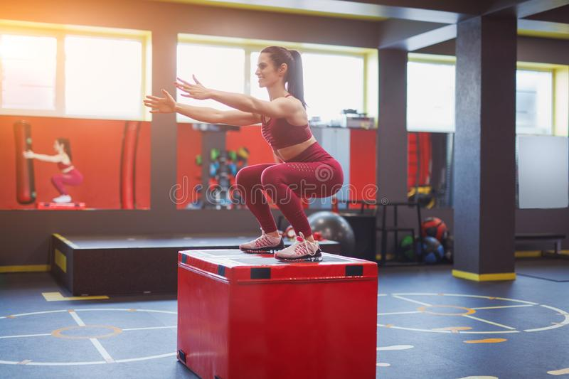 Adult cheerful woman training in gym royalty free stock photo