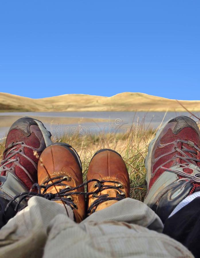 Adult and child legs and feet. Towards mountains and hills stock photos