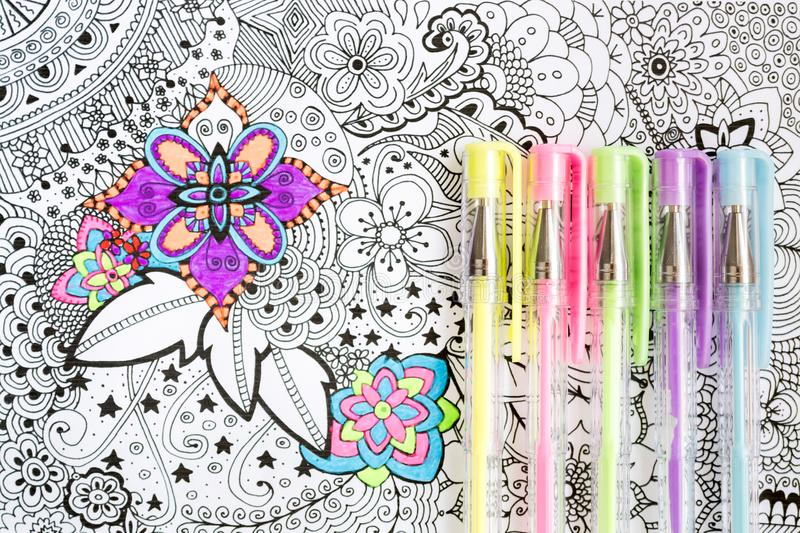 Adult coloring book, new stress relieving trend. Art therapy, mental health, creativity and mindfulness concept. Adult coloring page with pastel colored gel royalty free stock photos