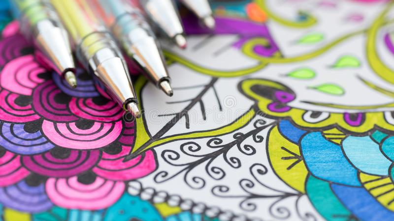 Adult coloring book, new stress relieving trend. Art therapy, mental health, creativity and mindfulness concept. stock photography