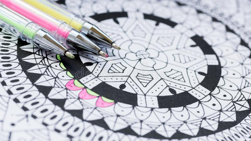 Adult coloring book, new stress relieving trend. Art therapy, mental health, creativity and mindfulness concept. Adult coloring page with pastel colored gel royalty free stock image