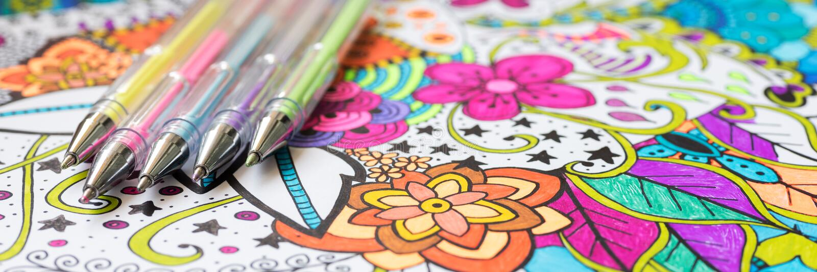 Adult coloring book, new stress relieving trend. Art therapy, mental health, creativity and mindfulness concept. Web banner. Adult coloring book, new stress stock images