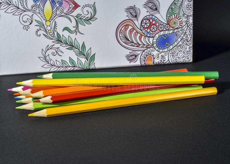 Adult coloring book trend, for stress relief. With colored pencils stock photos