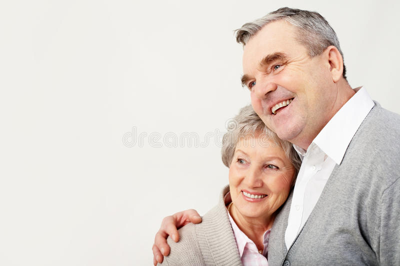 Adult couple. Portrait of adult man embracing her wife with love over white background royalty free stock photos