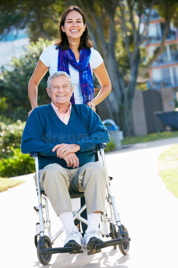 Download Adult Daughter Pushing Senior Father In Wheelchair Stock Image - Image: 27957133