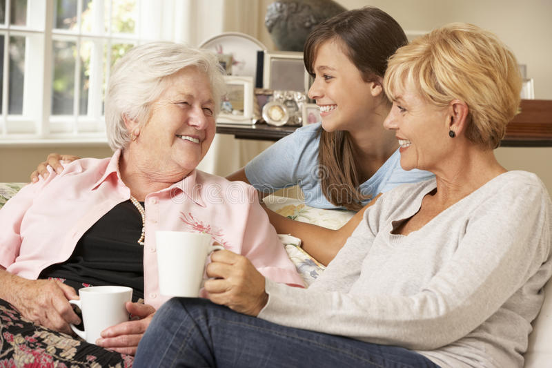 Adult Daughter With Teenage Granddaughter Visiting Grandmother royalty free stock photo