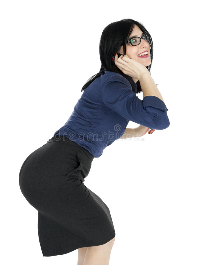 Business Woman Goofing on the Phone. An adult (early 30's) black haired caucasian woman, wearing a blue buttoned shirt and a dark gray skirt; looking at the stock images