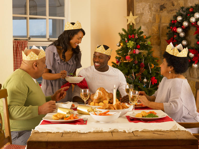 Adult family having christmas dinner. Adult African American family having Christmas dinner smiling stock photography