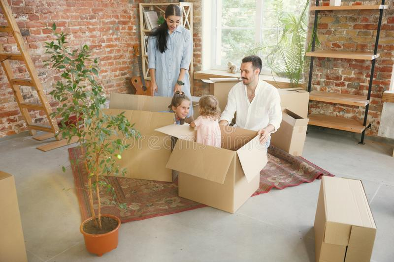 Adult family moved to a new house or apartment royalty free stock photos
