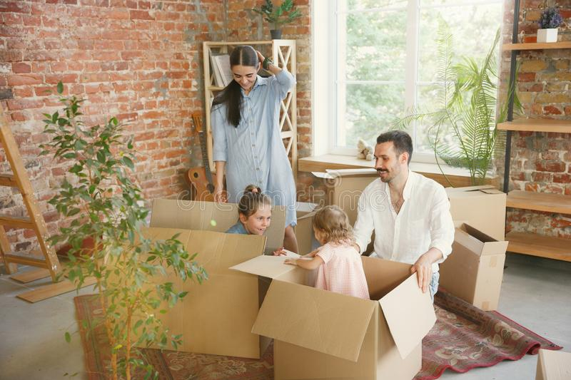 Adult family moved to a new house or apartment royalty free stock images