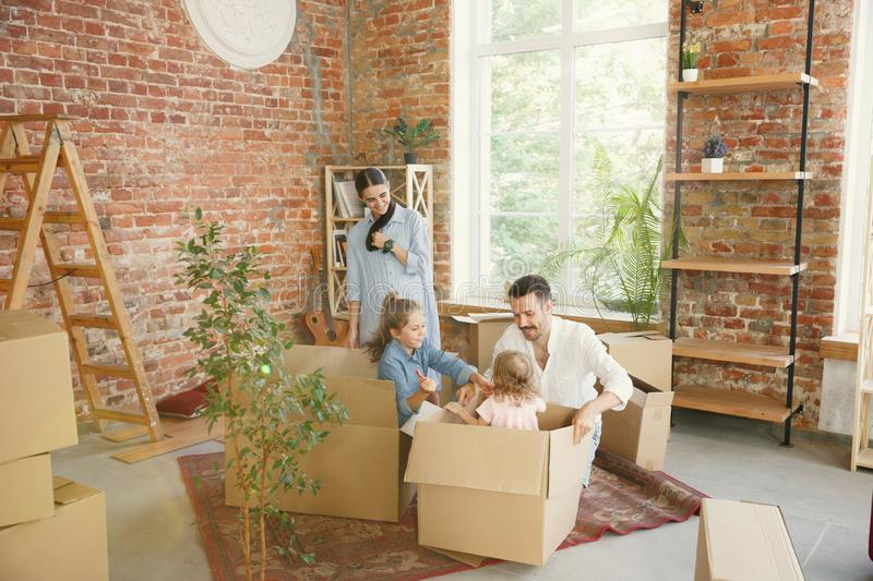Adult family moved to a new house or apartment stock photos