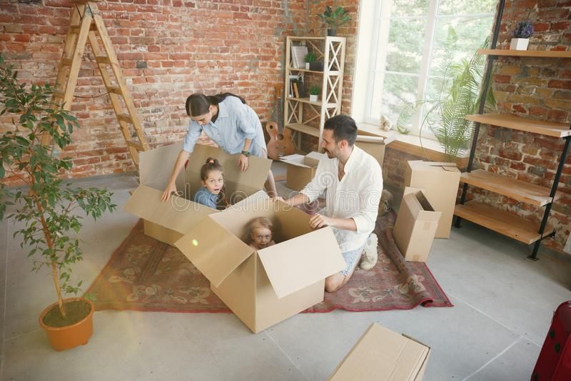 Adult family moved to a new house or apartment stock image