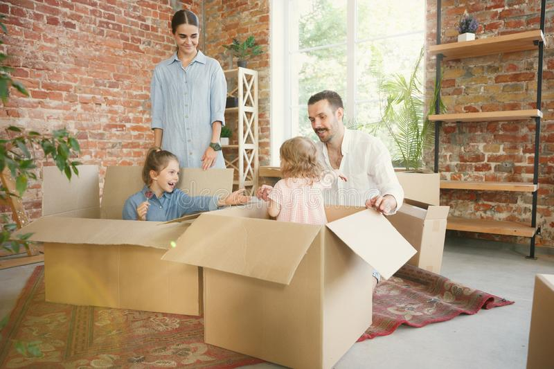 Adult family moved to a new house or apartment stock images