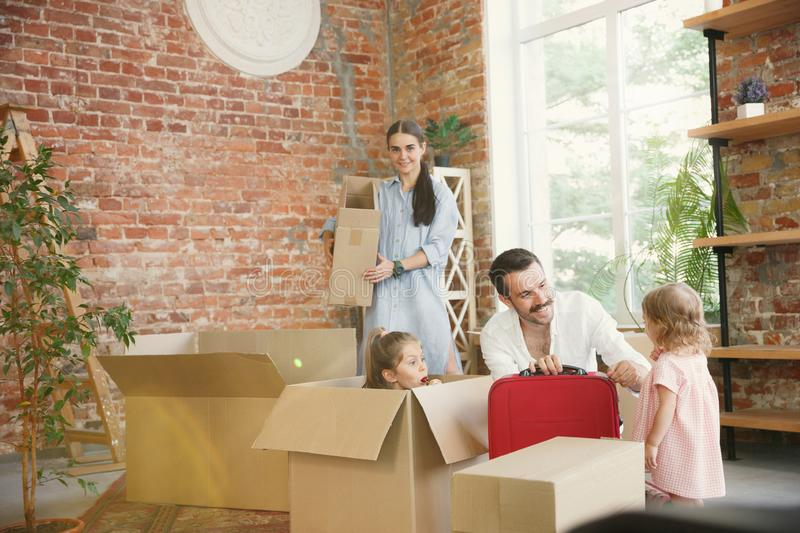 Adult family moved to a new house or apartment royalty free stock image