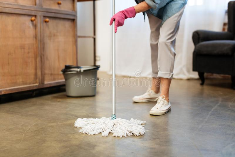 Adult female cleaner wearing rubber pink gloves stock image