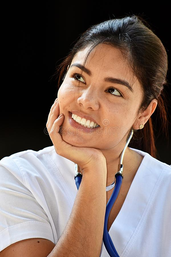 Adult Female Nurse Thinking. A pretty young Colombian adult female royalty free stock photo