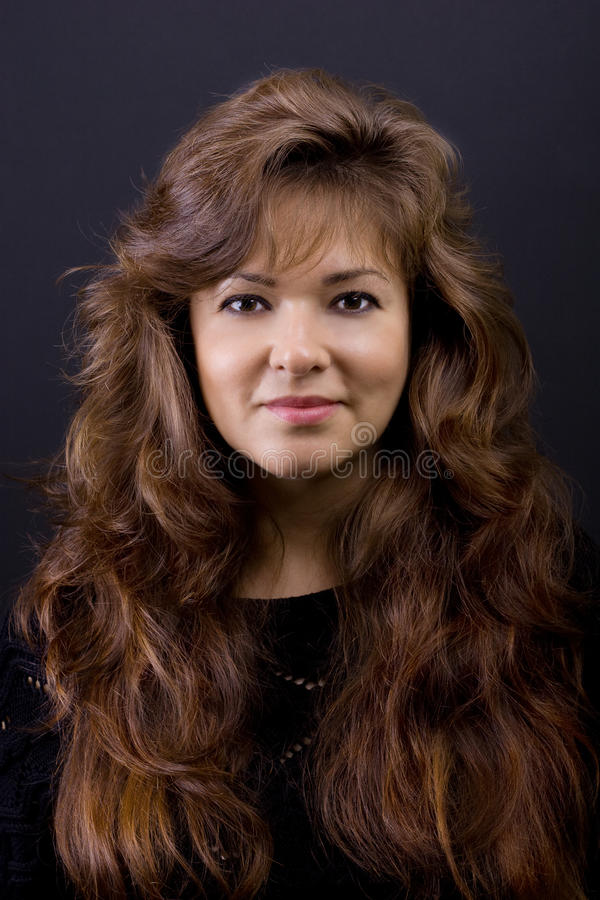 Adult female with perfect long hair stock photography