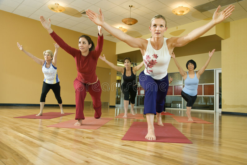 Adult females in yoga class. stock photography