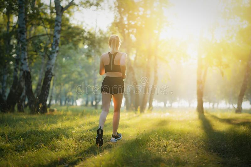 Adult fitness woman runner running on trail stock photos