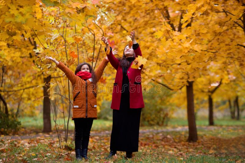Beautiful Mom And Daughter Teenager On A Picnic In Autumn ...