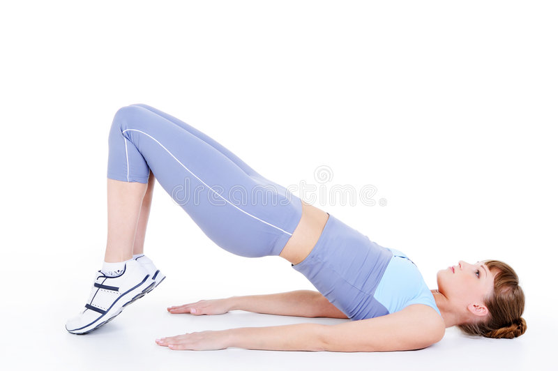 Adult girl working out on the floor. Beautiful adult girl working out on the floor - isolated on white background stock images