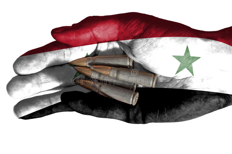 Adult hand with Iraq flag overlaid holding bullets. Isolated on white. Flag of Iraq overlaid the hand of an adult man holding four bullets. Conceptual image for stock photos