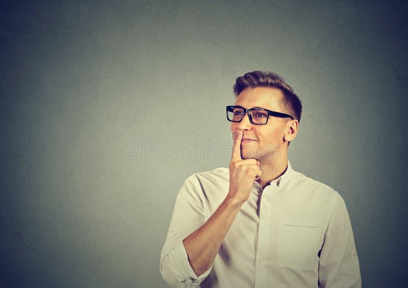 Dreaming adult man in eyeglasses stock image