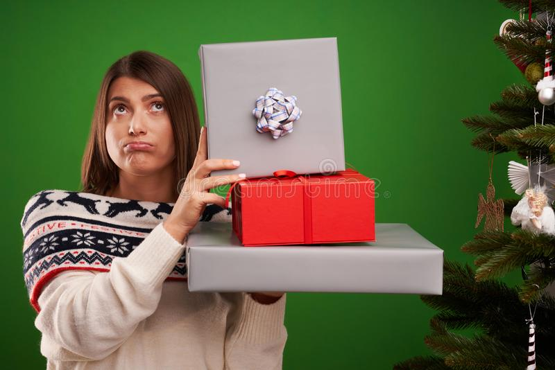 Adult happy woman with Christmas gift over green background royalty free stock images