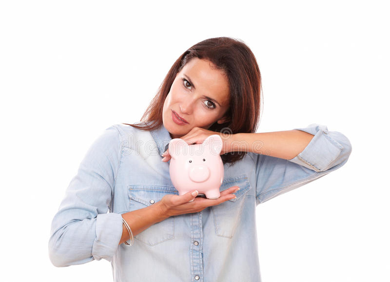 Adult hispanic female with her porcelain piggybank. Portrait of adult hispanic female on blue blouse with her porcelain piggybank smiling at you on isolated stock photos