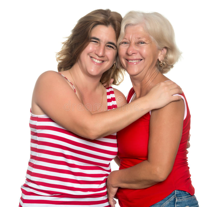 Adult hispanic woman hugging her mother royalty free stock photo
